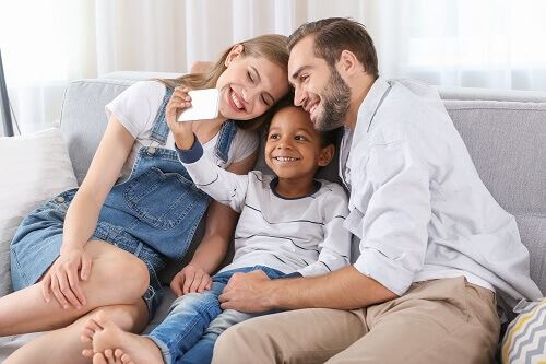 Couple with adopted child